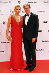 Actress Ferres and her partner Maschmeyer arrive on red carpet for Bambi 2013 media awards ceremony in Berlin