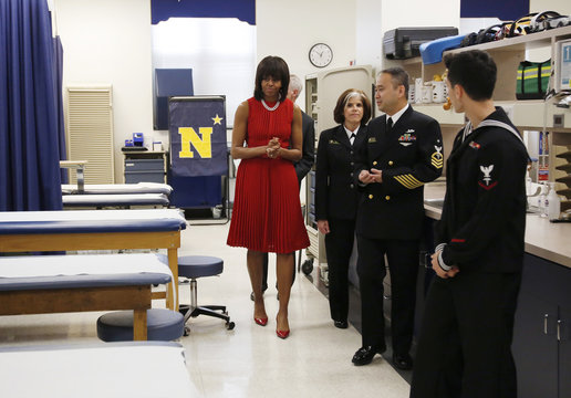 U.S. first lady Michelle Obama tours the orthopedic room with U.S. sailors in health care professions during her visit to the U.S. Naval Academy in Annapolis