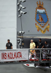 Indian Prime Minister Narendra Modi walks down the gangplank of the newly commissioned warship, INS Kolkata, after its commissioning ceremony at a naval base in Mumbai