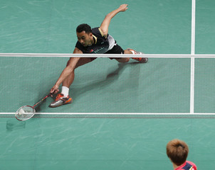 Tommy Sugiarto of Indonesia hits a return during his match against  Kenichi Tago of Japan in the men's singles semi-finals of the Malaysian Open Super Series 2014 badminton tournament in Kuala Lumpur January 18, 2014.