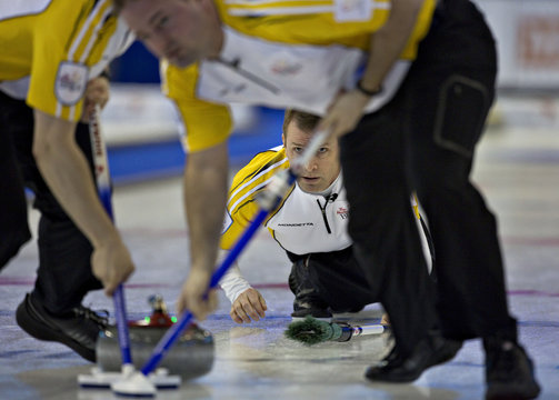 Manitoba skip Jeff Stoughton keeps his eye on the line of his shot during their page playoff game against Ontario at the Canadian Men's Curling Championships in Edmonton