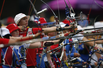 Jennifer Nichols of the U.S. takes aim during the women's archery individual ranking round of the London 2012 Olympics Games at the Lords Cricket Ground in London