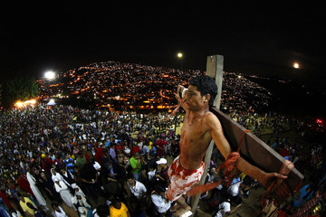 An actor is seen on the cross in a re-enactment of the crucifixion of Jesus Christ on Good Friday in Caracas' biggest slum of Petare