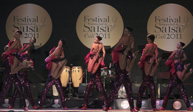 Colombian dance group Swing Latino participates in an exhibition dance during the 6th World Salsa Festival in Cali