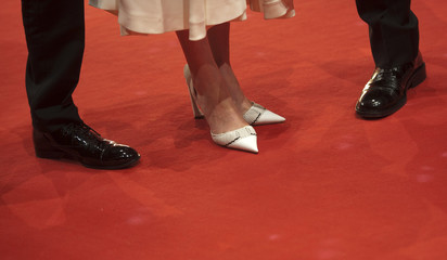 The shoes of actor Kenichi Matsuyama, actress Ito Ohno, and director Sabu are seen as they arrive for the screening for the movie 'Chasuke's Journey' ('Ten no chasuke') in competition at the 65th Berlinale International Film Festival, in Berlin
