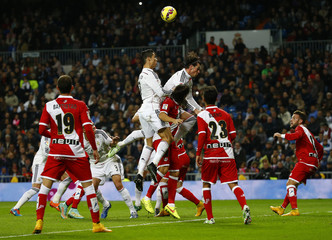 Real Madrid's Ronaldo and Bale try to score against Rayo Vallecano during their Spanish first division soccer match in Madrid