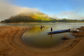 A fisherman casting a nets on during sunrise,thailand