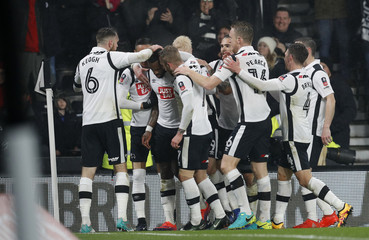 Derby's Darren Bent celebrates scoring their first goal with teammates