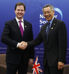 Britain's Deputy PM Clegg shakes hands with Singapore's PM Lee during a meeting on the sidelines of the Nuclear Security Summit in Seoul
