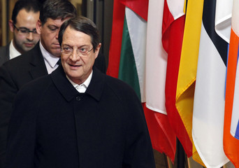 Cyprus' President Nicos Anastasiades leaves the European Council building in Brussels