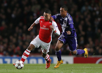 Arsenal's Alex Oxlade-Chamberlain is challenged by Anderlecht's Youri Tielemans during their Champions League soccer match at the Emirates stadium in London