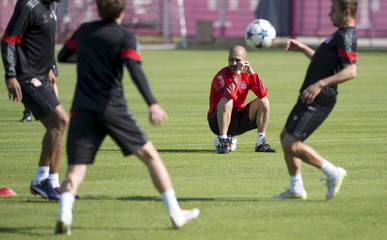 Bayern Munich's coach Pep Guardiola pauses during a training session at the club's training ground in Munich