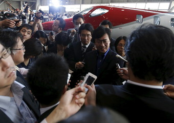 Honda Aircraft Company's President and Chief Executive Officer Fujino speaks to reporters after HondaJet makes first appearance in Japan at Haneda Airport in Tokyo