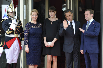 France's President Sarkozy and his wife Carla Bruni-Sarkozy pose with Russian President Medvedev and his wife Svetlana during the G8 summit in Deauville