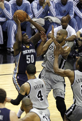 Memphis Grizzlies forward Randolph shoots against San Antonio Spurs forward Duncan during the first half of Game 1 of their NBA Western Conference final playoff basketball game in San Antonio