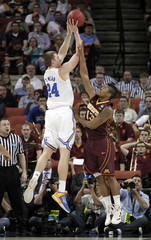 University of California Los Angeles forward Travis Wear shoots against University of Minnesota guard Maverick Ahanmisi during their second round NCAA basketball game in Austin, Texas