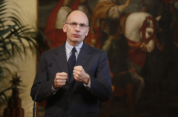 Italy's Prime Minister Letta gestures during a joint news conference with Gurria, secretary-general of the Organisation for Economic Co-operation and Development (OECD)  at Chigi Palace in Rome