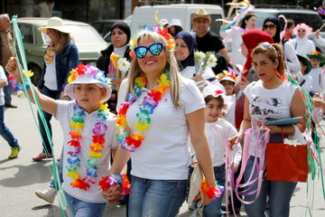 Residents attend a parade celebrating the coming of spring in Tripoli, north Lebanon