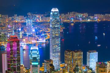 Hong Kong business district skyline at night.