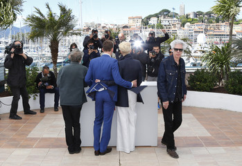 """Director Jim Jarmusch and cast members pose during a photocall for the film """"Only Lovers Left Alive"""" at the 66th Cannes Film Festival"""