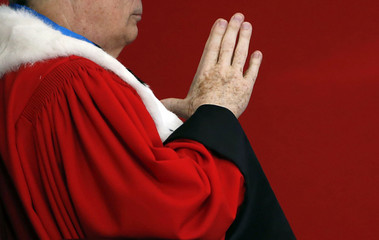 A magistrate reacts during the swearing-in ceremony for new magistrates at the French National Judicial Academy (ENM) in Bordeaux