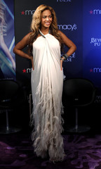 Singer Beyonce poses for a photo during an event to debut her newest fragrance Beyonce Pulse at Macy's store in New York