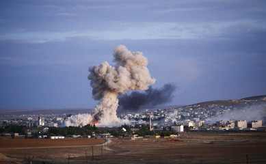 Smoke rises over Syrian town of Kobani after an airstrike
