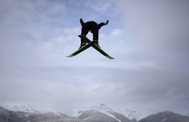A ski jumper soars through the air during practice round of the individual normal hill ski jumping at the Vancouver 2010 Winter Olympics in Whistler.