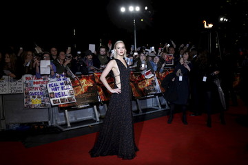 """Actress Lawrence poses for photographers on the red carpet at the UK premiere of """"The Hunger Games: MockingJay Part 2"""" at Leicester Square in London, Britain"""