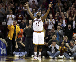Cavaliers' Davis raises his arms in celebration after hitting a shot during the fourth quarter of their NBA basketball game against the Miami Heat in Cleveland