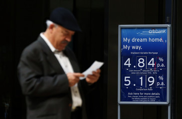 A man checks a receipt after leaving a Citibank branch in central Sydney