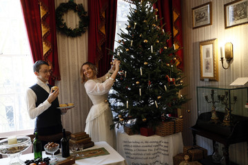 Actors pose for a photograph at the Charles Dickens Museum in central London