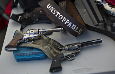 A monogrammed gun belt and a pair of single action western style revolvers are seen at the Canadian Open Fast Draw Championships in Aldergrove