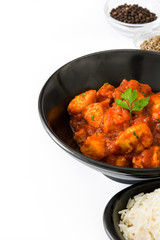 Chicken tikka masala in bowl isolated on white background