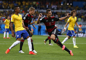 Germany's Miroslav Klose scores a goal during the 2014 World Cup semi-finals between Brazil and Germany at the Mineirao stadium