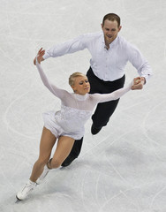 Caitlin Yankowskas and John Coughlin skate during the pairs free skate program at the U.S. Figure Skating Championships in Greensboro