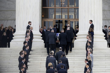The casket containing the remains of the late U.S. Supreme Court Justice Antonin Scalia is carried up the steps of the Supreme Court after it arrived to lie in repose in the building's Great Hall in Washington