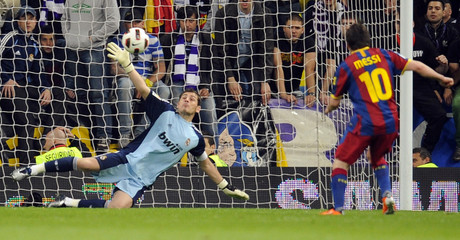 Barcelona's Messi scores a penalty past Real Madrid's goalkeeper Casillas during their Spanish first division soccer match at the Santiago Bernabeu stadium in Madrid