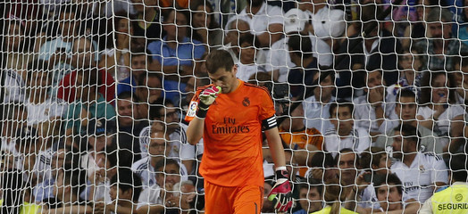 Real Madrid's goalkeeper Casillas reacts after conceding Atletico Madrid's second goal during their Spanish first division soccer match in Madrid