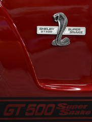 Logos of 2013 Shelby Ford Mustang GT 500 Super Snake being displayed at the North American International Auto Show in Detroit