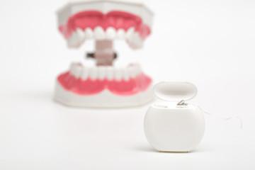 dental  floss on white background
