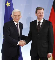 German Foreign Minister Westerwelle and European Parliament President Buzek shake hands in Berlin