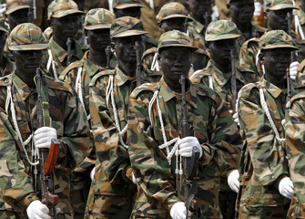 SPLA soldiers hold rifles during a rehearsal of the Independence Day ceremony in Juba