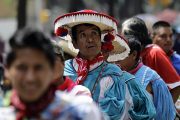 Members of the indigenous community take part in a march to commemorate the Day of the Race in Mexico City