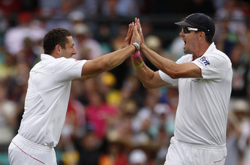 Pietersen congratulates Bresnan for taking the wicket of Clarke during the fifth Ashes cricket test in Sydney