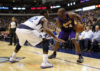Los Angeles Lakers Bryant looks to drive on Dallas Mavericks O.J. Mayo during their NBA game in Dallas