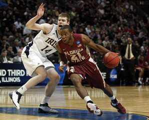 Snaer of Florida State gets around Notre Dame's Martin during the first half of their third round NCAA basketball game in Chicago