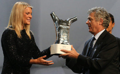 Olympique Lyon's Ada Hegerberg receives from UEFA President Angel Maria Villar the Best Player UEFA 2015/16 Award during the draw ceremony for the 2016/2017 Champions League Cup soccer competition at Monaco's Grimaldi in Monaco