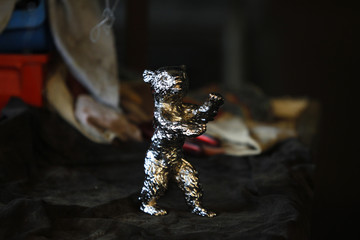 Berlinale bear award statuette is pictured during gilding process in Berlin