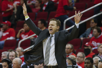 Oklahoma City Thunder head coach Brooks signals to his team during their match against the Houston Rockets in game six of their first round NBA basketball playoff game at the Toyota Center in Houston